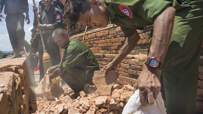 Using brooms and their hands, soldiers and residents of the ancient Myanmar city famous for its historic Buddhist pagodas began cleaning up the debris a powerful earthquake shook the region, killed at least four people, and damaged nearly 200 temples. Picture: Hkun Lat