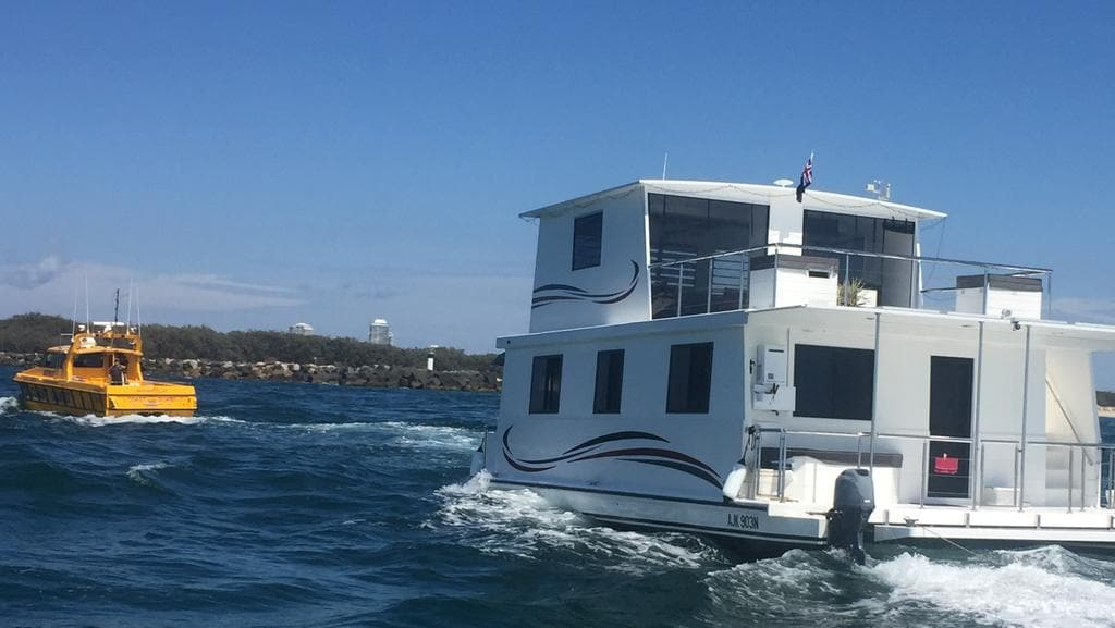 Amateur sailors rescued by coast guard in sinking for Minimalist house boat