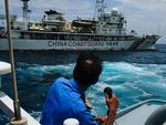 A member of the Malaysian Navy makes a call as their ship approaches a ship belonging to the Chinese Coast Guard during an exchange of communication in the South China Sea. Picture: Rahman Roslan/Getty Images