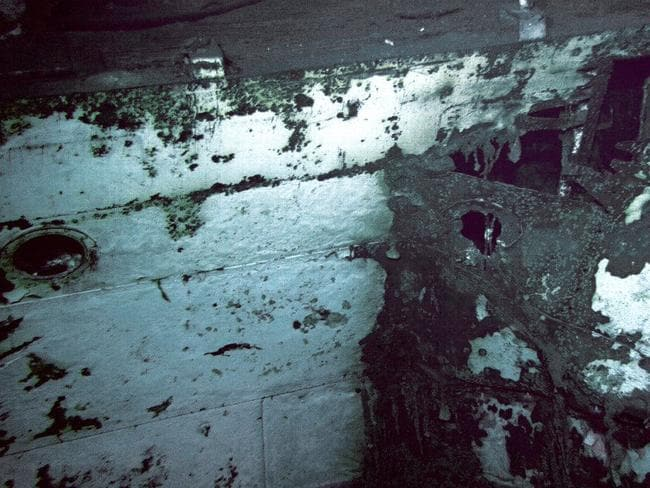 Torpedo damage shown in the side of the USS Indianapolis. Close-up details of the battle damage may reveal how the cruiser sank so fast. Picture: Twitter / Paul Allen