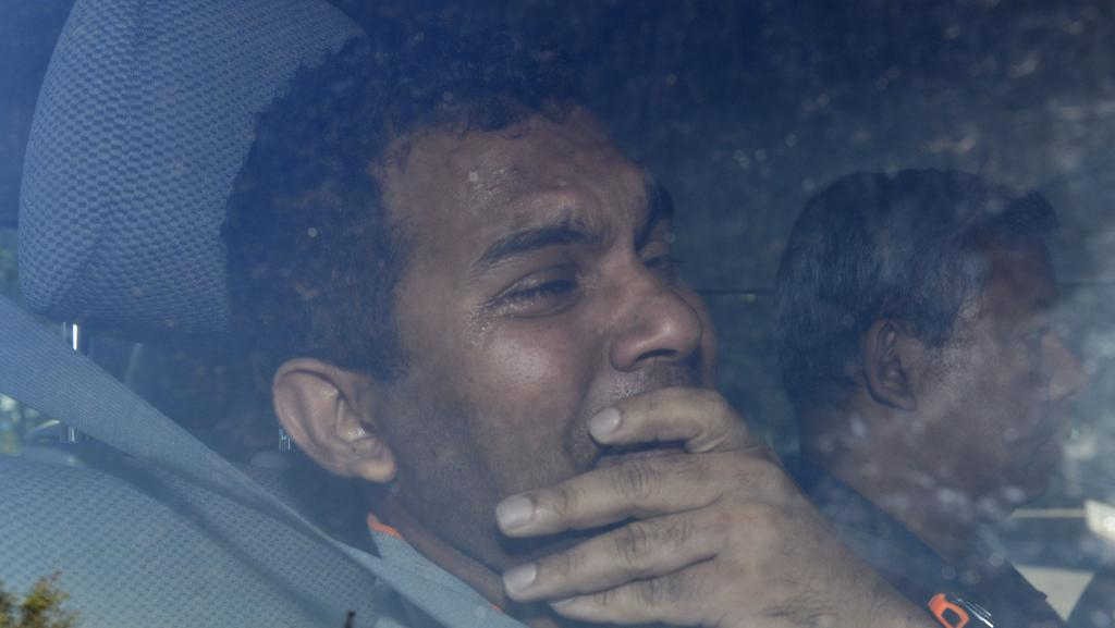 Forced removal: The tearful Sri Lankan father taken to the airport, after being removed from the Redcliffe detention centre. Pictures: Alf Sorbello