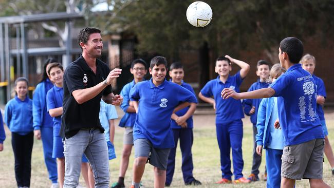 Harry Kewell with kids at his new football Academy.