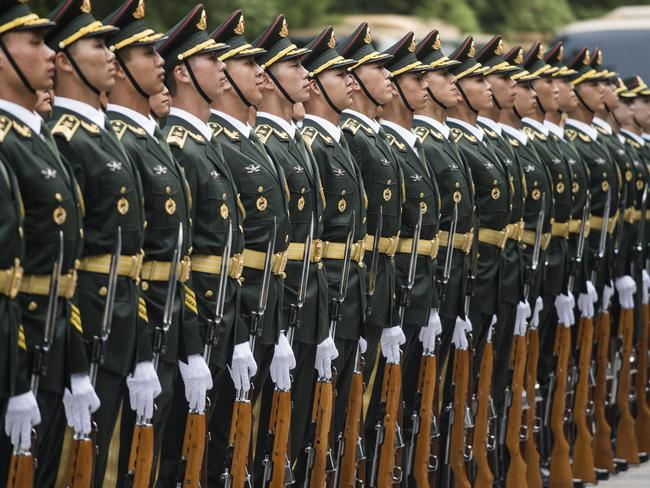 Chinese paramilitary guards prepare prior to the welcome ceremony for Luxembourg's Prime Minister Xavier Bettel and Chinese Premier Li Keqiang at the Great Hall of the People in Beijing on June 12, 2017. Bettel is on a four-day visit to China. / AFP PHOTO / FRED DUFOUR