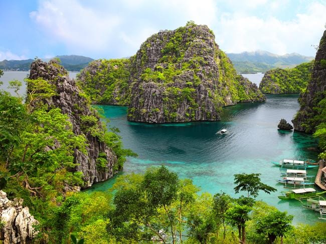 Palawan is known for dramatic limestone islands and turquoise water.