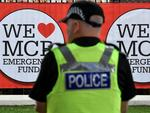 Police officers patrol around Old Trafford Cricket Ground ahead of the One Love Manchester tribute concert in Manchester on June 4, 2017. Picture: Anthony Devlin/AFP