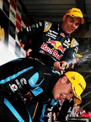 Lowndes drenches McLaughlin with champagne. Picture Simon Cross.