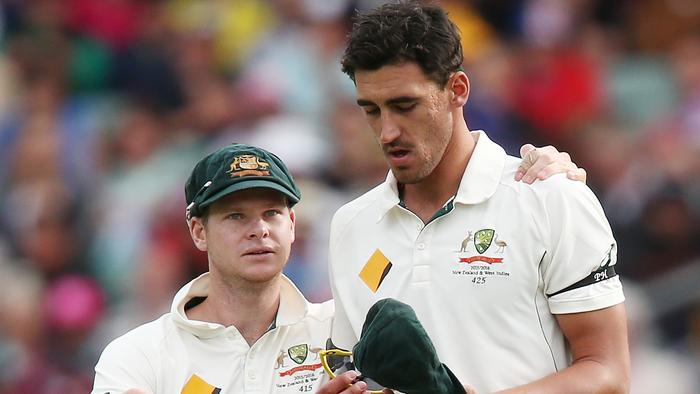 ADELAIDE, AUSTRALIA - NOVEMBER 27: Mitchell Starc of Australia reacts in pain as he is comforted by Steve Smith during day one of the Third Test match between Australia and New Zealand at Adelaide Oval on November 27, 2015 in Adelaide, Australia. (Photo by Morne de Klerk/Getty Images)