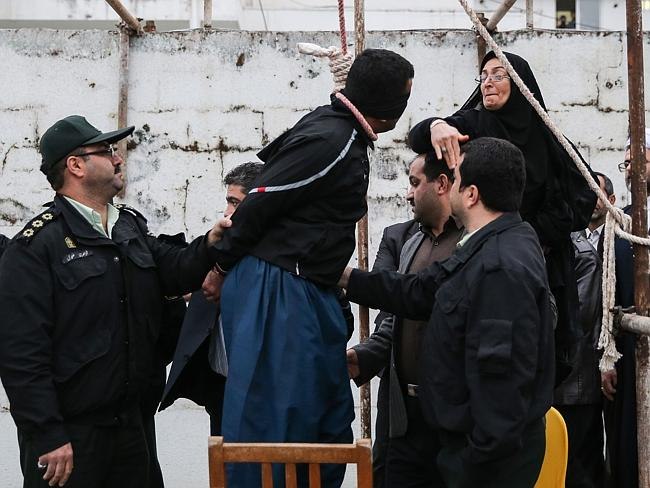 The slap ... Samereh Alinejad slaps her son's killer, before sparing his life. Mrs Alinejad says she decide to let the killer live after her son appeared to her in a dream, saying he was at peace. Picture: AFP/ARASH KHAMOOSHI/ISNA