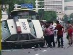 <p>A video grab from CCTV shows people turning over a police car in Urumqi. Picture: Reuters</p>