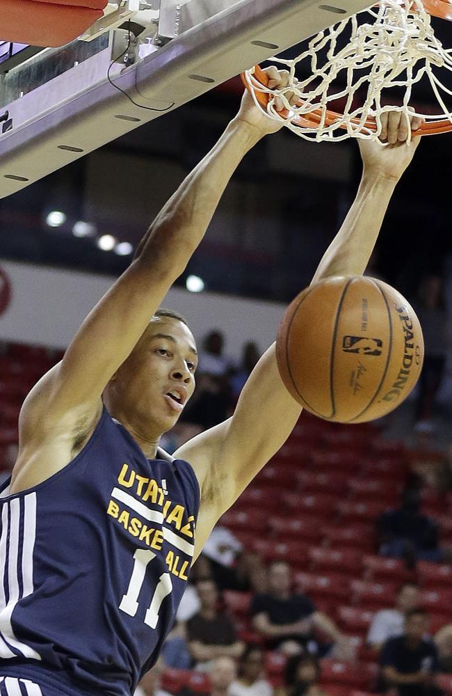 Utah Jazz's Dante Exum dunks during the first half of an NBA summer league game.