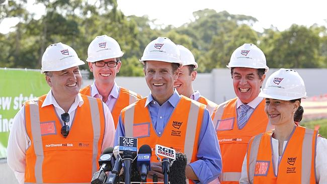 NSW Premier Mike Baird (centre) and Minister for Transport Gladys Berejiklian (right), with local MP's, David Elliott (Baulkham Hills), Dominic Perrottet (Castle Hill), Matt Kean (Hornsby) and Ray Williams (Hawkesbury) inspect construction progress on the $8.3 billion North West Rail Link at the future Cherrybrook. Picture: Bradley Hunter