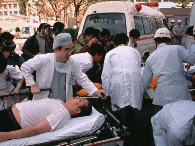 Subway passengers en route to hospital after sarin nerve gas was left on trains in central Tokyo. Picture: Chiaki Tsukomo/AP