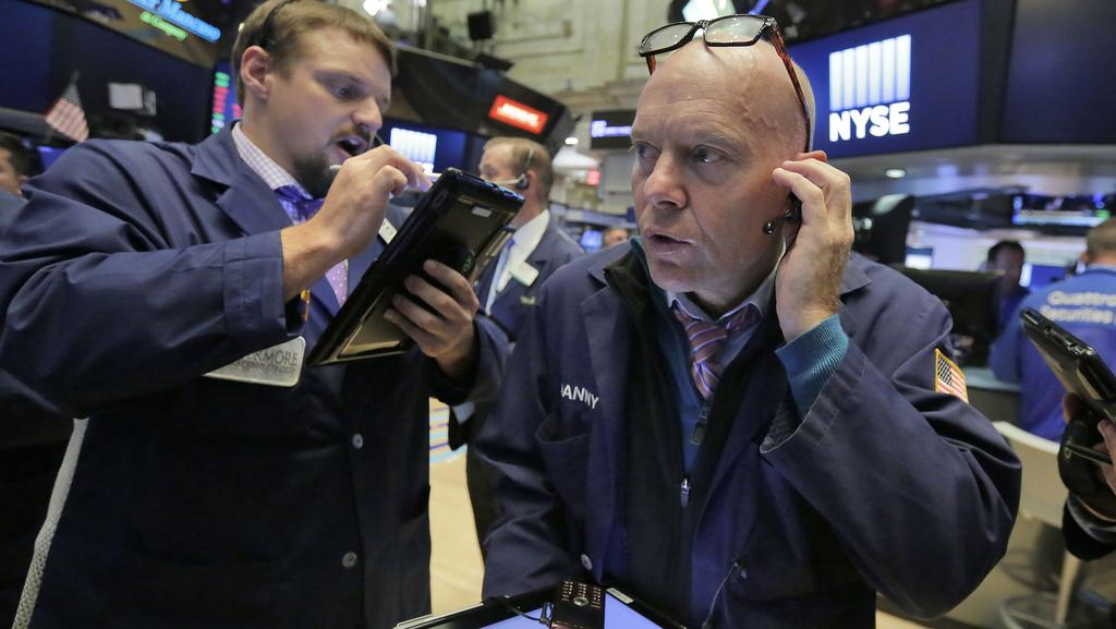 Traders Michael Milano, left, and Daniel Leporin work on the floor of the New York Stock Exchange, Monday, 7 August 2017. Picture: Richard Drew/AP