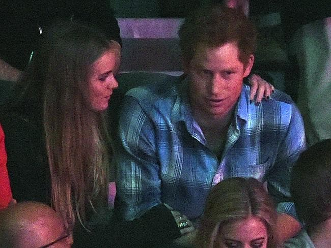 Prince Harry and Cressida Bonas got a bit touchy feely in the crowd at the We Day UK event.
