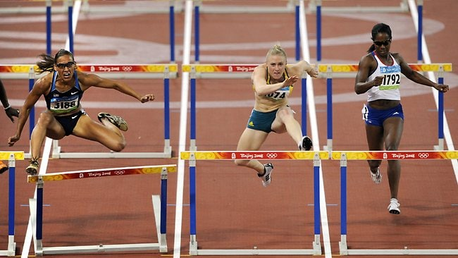 Aussie Sally McLellan (Sally Pearson) races to a silver medal in the 2008 Olympics while favourite Lolo Jones (left) crashes on the final hurdle. Picture: Michael Dodge