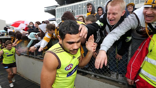 Cyril Rioli gets the support of Hawk fans who braved bad weather to see the team train for the Grand Final. Picture: Alex Coppel