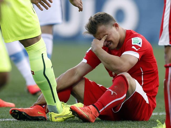 Switzerland's Xherdan Shaqiri breaks down after his team's loss to Argentina.