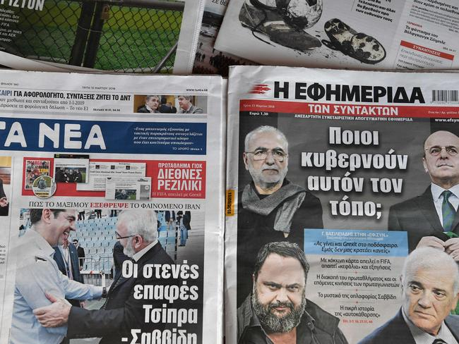 A picture taken in Athens on March 13, 2018 shows frontpages of daily newspapers bearing titles related to a football incident.