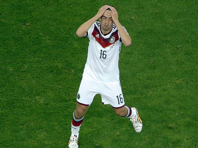 Germany's Philipp Lahm holds his head.