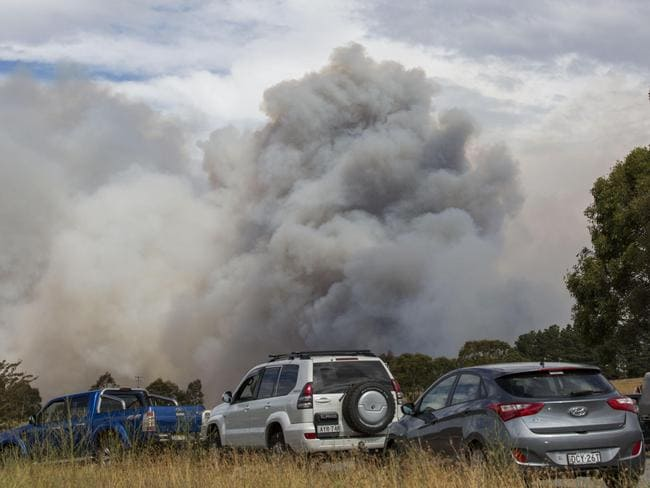 Massive smoke plumes rise from the fire near Queanbeyan. Picture: Sean Davey