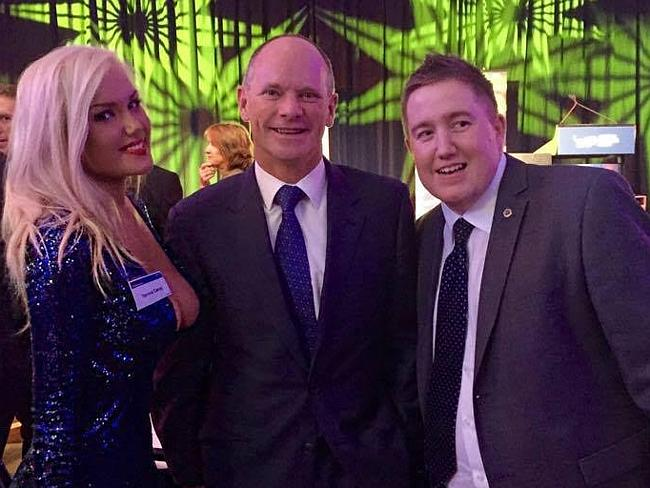 "Ms Candy, pictured with Campbell Newman and Neil Symes at an LNP dinner, says she's not a feminist but an ""egalitarian""."