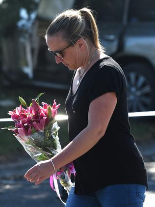 A lady arrives to lay flowers at the scene. Picture: Nicole Garmston