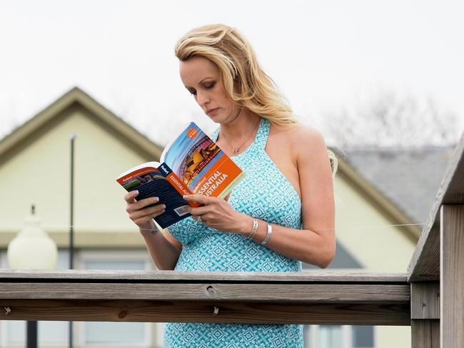 She was pictured staring longingly at the book. Picture: Backgrid