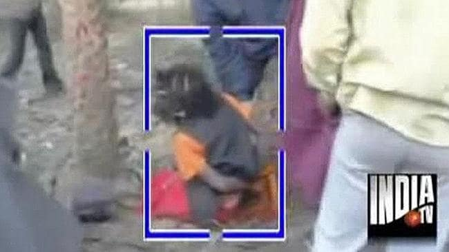 Arrest ... Police and the public surround Lakkhikanto Karmakar after the baby's body was found. Picture: India TV