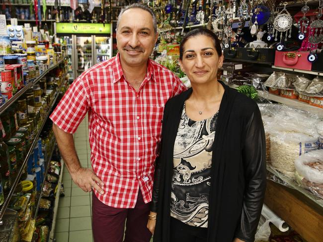 Proud but worried are Karam's parents Rafid and Maysa Elias, pictured at their mixed business in Fairfield Plaza, Sydney. Picture: Justin Lloyd