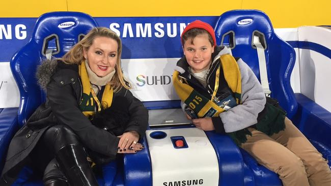 Now they ARE happy smiles as we set to slide down the ANZ Stadium sideline.