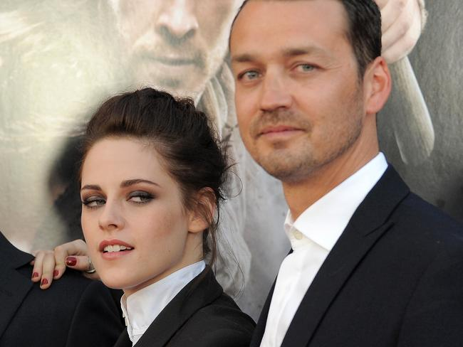 Kristen Stewart was caught cheating on Robert Pattinson with director Rupert Sanders (left).
