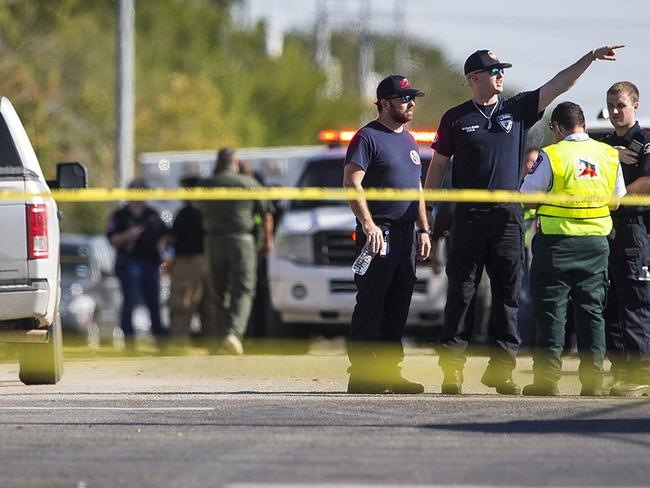 Law enforcement officials work the scene of a fatal shooting at the First Baptist Church in Sutherland Springs, Texas. Picture: AP