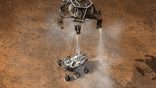 An artists impression of the moment that a rocket-pack detached NASA's Curiosity onto the Martian surface. Picture: NASA