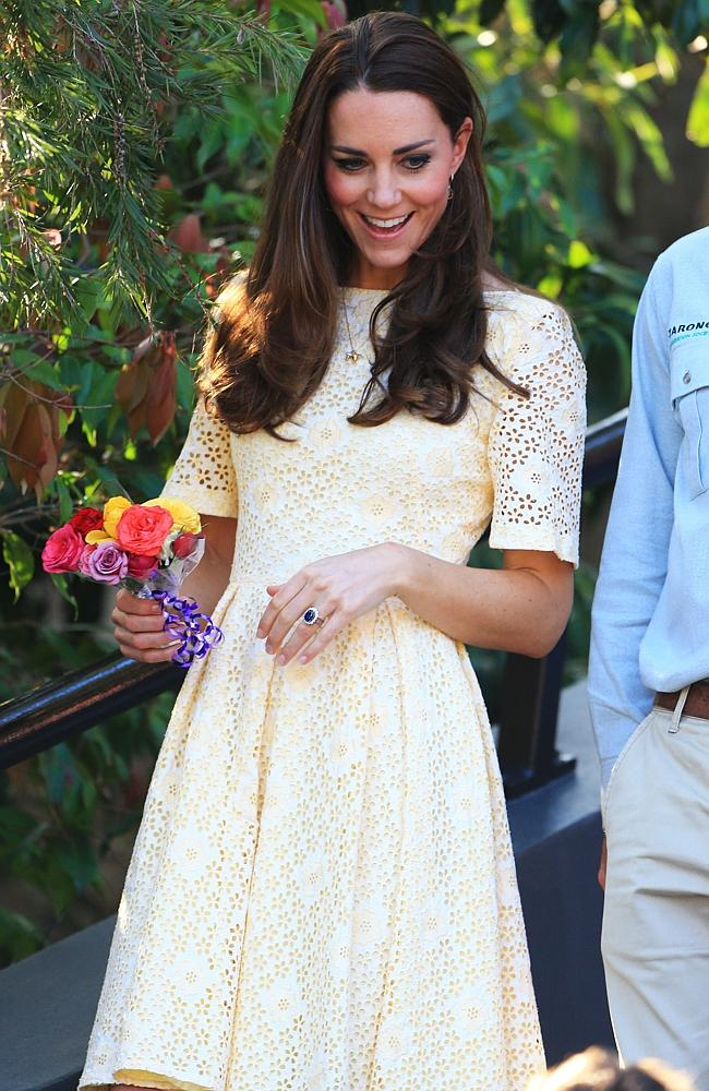 Mystery designer ... Duchess Kate in the primrose yellow dress during a visit to Taronga Zoo. Picture: Adam Taylor