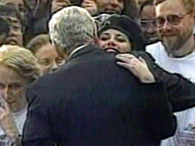 Intern Monica Lewinsky embraces US President Bill Clinton during White House lawn party in 1996. Picture: AP