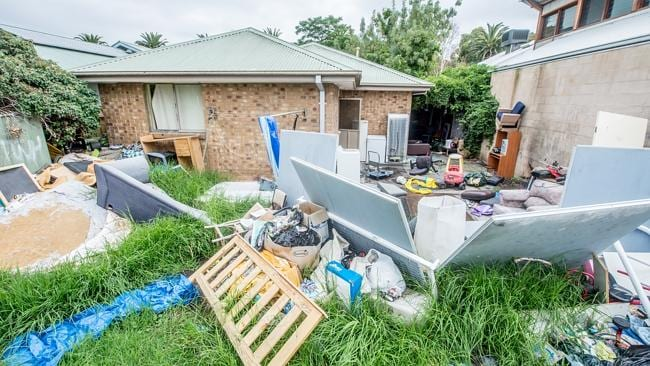 Couches, fridges, washing machines and office wall partitions were among hundreds of items of junk in the backyard.