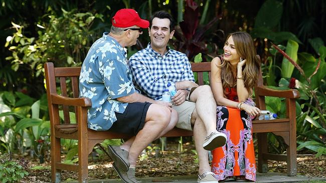 Having a blast ... Ed O'Neill, Ty Burrell and Sofia Vergara have a laugh during a break from filming in Sydney's Botanic Gardens. Picture: Craig Greenhill