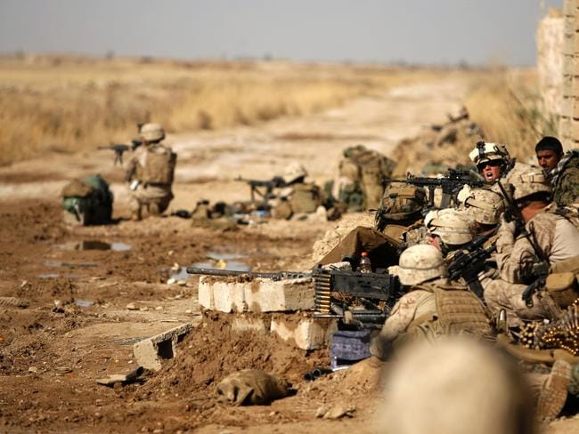 Live fire ... The oil facility was quickly taken after a short firefight with jihadists. This file photo shows US marines deployed in Afghanistan. Source: AP