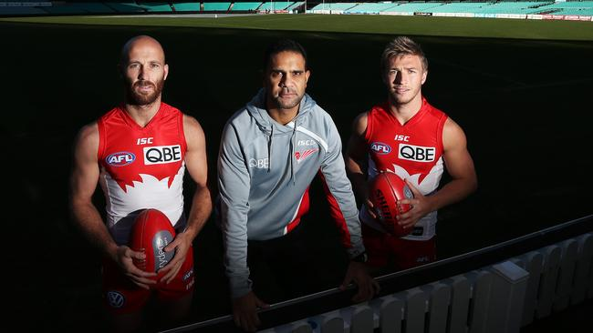Michael O'Loughlin with Sydney-raised Swans captains Kieren Jack and Jarred McVeigh. Picture: Phil Hillyard
