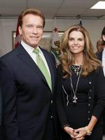 California Gov. Arnold Schwarzenegger and his wife Maria Shriver pose for photos before they meet at the second Governors' Global Climate Summit in Los Angeles. The former California governor originally indicated in a divorce filing that he does not want to pay Shriver spousal support. Schwarzenegger filed an amended response in his divorce Monday, July 25, 2011 indicating that he is now willing to pay Shriver spousal support and for her divorce lawyer. Shriver filed divorce papers July 1, to end their marriage of 25 years. (AP Photo/Reed Saxon)