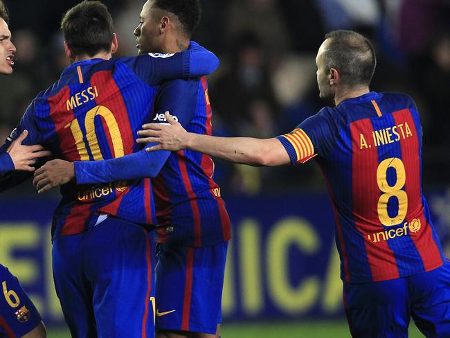 FC Barcelona's Lionel Messi, center, Iniesta, right.
