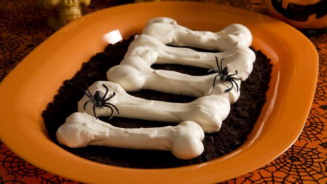 Meringue bones on dirt (crushed Oreo Cookies).