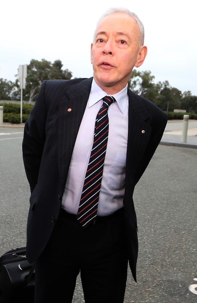 Family First ... Senator Bob Day arriving for his first day of Orientation at Parliament House in Canberra.