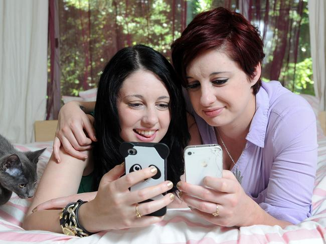 What guys are out there ... Kathleen Manning-Dallman, 21, and her twin sister Helen check out the dating scene. mobile phones looking at the dating scene. Picture: Keryn Stevens