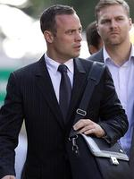 Oscar Pistorius accompanied by relatives, arrives at the high court in Pretoria. Picture: AP Photo/Themba Hadebe