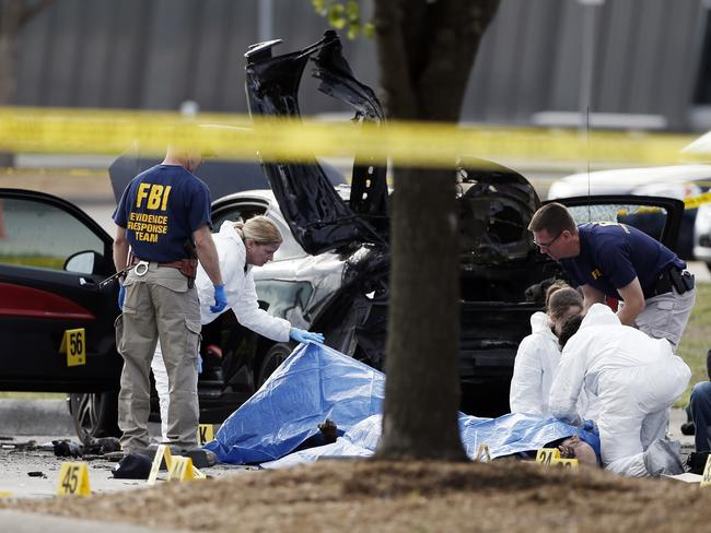 Death scene ... FBI crime scene investigators document the area around two dead gunmen outside the Curtis Culwell Center. Picture: Brandon Wade/AP