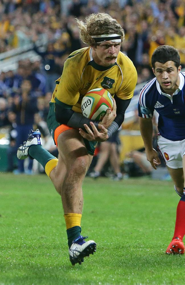 Nick Cummins scores a try for the Wallabies against France at Suncorp Stadium last month.