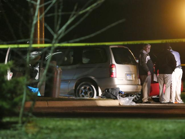 Police investigate the scene, where people were shot in vehicles in Kalamazoo, Michigan. Picture: Mark Bugnaski/Kalamazoo Gazette