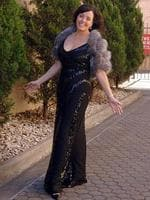 TV presenter Kelly Nestor wearing a George Gross and Harry Watt-designed black sequinned gown.