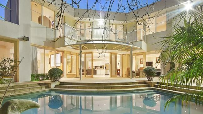 18 Denham Place, Toorak. This Miami inspired entertainer has tropical inspired gardens and a heated pool outside